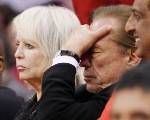 Los Angeles Clippers owner Sterling puts his hand over his face in the second half of an NBA basketball game in Los Angeles